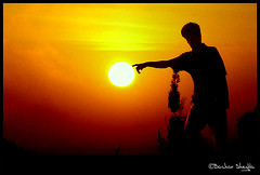 Touching the Sun ! :) (Bashar Shglila) Tags: sunset red orange sun silhouette touch libya et zeitgeist touching libyen lbia libi libiya liviya libija colourartaward shahat  rubyphotographer    lbija  lby libja lbya liiba livi