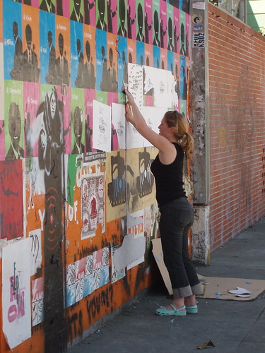 Julia wheatpasting on Deappropriation Wall