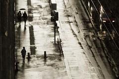 The Deluge (edouardv66) Tags: street people color wet rain umbrella dark children switzerland nikon women suisse geneva walk 85mm backlit nikkor genève noncolor d700