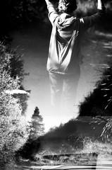 (Highburnate) Tags: trees light shadow wild summer bw woman plants sun sunlight canada laura tree film girl grass youth forest trek 35mm hair outside woods soft shadows wind spirit walk warmth august vision alberta trippy spruce grl grrl nikonem sprucetrees nathalieweiswasser filmyo laurasaik