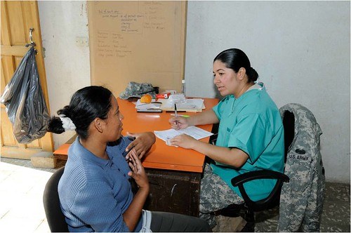 Staff Sgt. Aleya Robleto discusses a patient's needs at the U.S. Army Reserve dental clinic in Mateare, Nicaragua