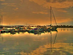 Golden harbor.. (Metin Canbalaban) Tags: voyage trip travel sunset sea vacation sun holiday reflection turkey boat trkiye deniz izmir yansma turkie urla trkie zbek inciralt metincanbalaban