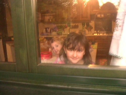 Alice & Sofia peeping out of the kitchen window to bid us Tata
