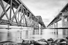Benicia Bridge (Ron Rothbart) Tags: california longexposure bridge blackandwhite bw water monochrome waterfront nd benicia hdr beniciamartinezbridge neutraldensityfilter 10stopfilter vision:text=0564 vision:outdoor=0911 vision:sky=0763