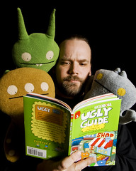 It Sure Ain't A Frommer's Guide (Cayusa) Tags: selfportrait self reading bart read 365 poe day57 uglydolls uglies babo cinko 365days yearthree 36557 dayfiftyseven 365day57 uglyguide 365daysyearthree uglyguidebook