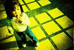 tic-tac-step (golfpunkgirl) Tags: baby girl yellow lomo lca xpro lomography crossprocessed sofia squares pavement philippines baguio frowning cutes fujiprovia400