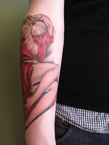 Pin-up tattoo by Strandell. The pin-up girl was completed in almost five
