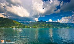 Panoramic View - Zell Am See (Essa Al-Sheikh - @Bo3awas) Tags: blue summer sky lake mountains salzburg green clouds canon boats photography austria see am europe sigma filter essa 2008 1020  zell hoya   alsheikh  xti 400d