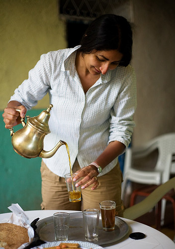 Reena pouring mint tea