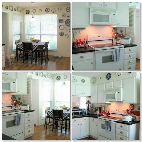 Nice white kitchen set and kitchen cabinet. There are elegant white cabinet, clean wooden floor  and  dining table