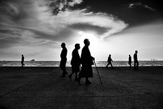 ...- stavrosstam (stavrosstam) Tags: street people bw cloud greece thessaloniki passing figures silouettes salonika