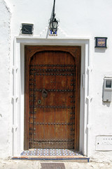 Moroccan Doorway (cwgoodroe) Tags: tangier tanger morocco moroccan africa ferry plane bus doorway arab muslim mosque merchant street arabic metaldoors colors summer streetlife vibrant poor kasbah casbah casbha ancient moors christians fishmerchant artistic ocean city sea sand sun panasonic pentax continent people script merchants children metal doors colorful conservative fish monger cafe friendly vegtable old cleric casba dailylifeportrait sadfaces