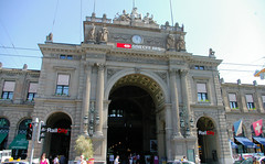 Rail City (Zurich Main Banhoff) (cwgoodroe) Tags: blue roses summer church water fountain switzerland ancient europe arch swiss zurich gothic sunny german column archway waterway doric carvedstone christion suiess