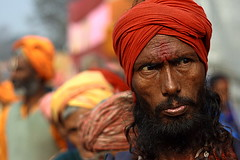 red turban | Kolkata (arnabchat) Tags: red portrait india face look eyes dof explore turban kolkata bengal calcutta bangla pilgrim sadhu sankranti westbengal makarsankranti canon400d arnabchat arnabchatterjee