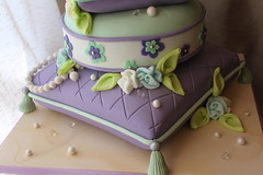 Close up of bottom tiers (Andrea's SweetCakes) Tags: diamonds purple weddingcake pearls tassels mintgreen doli ribbonroses stackedpillows ribbonleaves