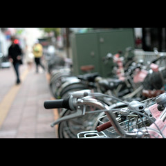 a piece from Japan (_nejire_) Tags: street fab people man bike bicycle japan canon eos 50mm kiss bokeh pavement canonef50mmf18 explore 50mmf18 3pm niftyfifty 10faves 25faves nejire 400d eos400d canoneos400d kissx fave10 mhashi fave25 6917394g8am 63334g2am
