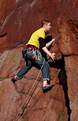 Concentration written on the face (gornabanja) Tags: uk november red nature face sport yellow rock stone shirt fun outdoors scotland concentration nikon edinburgh december colours searchthebest d70 action climbing colourful rockclimbing lead quarry inthelead