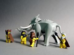 Men hunting Mastodon with spears