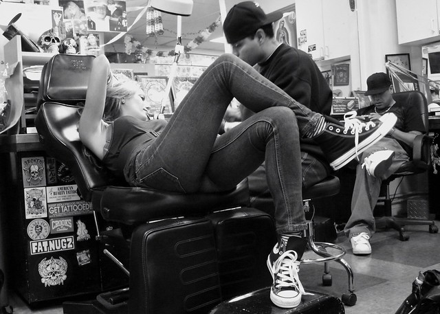 Girl getting tattooed in West Hollywood at Shamrock Tattoo. Sunset Strip, Ca