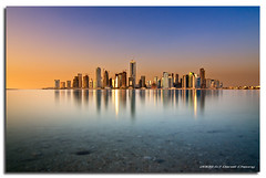 Doha - The Morning Mirage (DanielKHC) Tags: sea skyline digital sunrise reflections island dawn interestingness high nikon bravo cityscape dynamic surreal tranquility calm explore mirage range dri hdr futuristic doha qatar blending d300 dynamicrangeincrease nd400 danielcheong bratanesque danielkhc tokina1116mmf28 gettyimagesmeandafrica1
