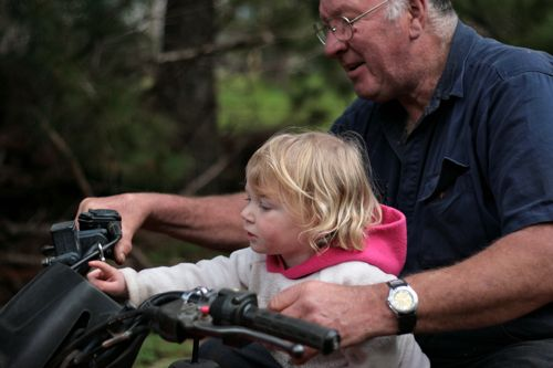 she's telling him how to start his motorbike!