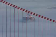 found this one in a dusty corner of my hard drive (grwsh.marcel) Tags: canon 40d canon40d 100400mm goldengatebridge sanfrancisco boot boat ship schip vessel containers brug bridge brucke tien kabels cables lines lijnen mist fog fogged ghost ghostship rook smoke