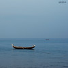valiyathura, trivandrum (sash/ slash) Tags: morning blue sea people sunlight india fish beach boat nikon fishermen kerala sash journey trivandrum lighted d80 sajesh shanghumugham valiyathura