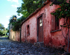 Cobblestone Street in Colonia, Uruguay (Yelena_YK) Tags: street door old travel red color building green window architecture rural uruguay photography town nikon place natural pastel famous colonial culture nopeople scene unesco cobblestones spanish colonia multicolored worldheritage naturalcolors portugues historico ruralscene traveldestination coloniadesacramento nikond80 erabarrio streetsofcolonia yelenayk