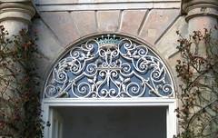 Doorway of orangery, Powis Castle (wonky knee) Tags: door uk wales sandstone wroughtiron orangerie orangery powiscastle welshpool ferrobattuto fanlight schmiedearbeit ferforge