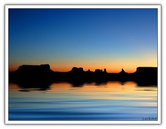 Flooded Monument Valley (Lars Kehrel) Tags: blue sunset panorama orange sun reflection film monument water silhouette set sunrise john wasser sonnenuntergang flood wayne samsung s lars valley western romantic blau rise sonne sonnenaufgang schwarz contour warming global globalwarming reflektion untergang coulisse 1050 flut reflektionen sonnen globale romantisch aufgang kulisse feflections kontur filmkulisse globaleerwrmung s1050 erwrmung kehrel