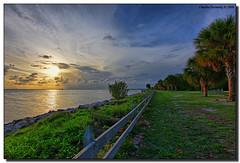 Evening (Fraggle Red) Tags: statepark sunset clouds fence palms evening rocks florida jpg hdr keybiscayne biscaynebay capeflorida billbaggscapefloridastatepark 3exp canonef1635mmf28liiusm miamidadeco theperfectphotographer dphdr vosplusbellesphotos