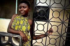 Girl in Yellow Kitenge (dunia duara) Tags: africa people youth tanzania blog women daressalaam kitenge swahilicoast duniaduarablog