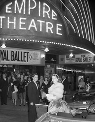 Waratah Spring Festival Princess 1958 arrives in an open car for the Royal Ballet at the Empire Theatre, Sydney, 1 September 1958 / photographer Ken Redshaw, Australian Photographic Agency