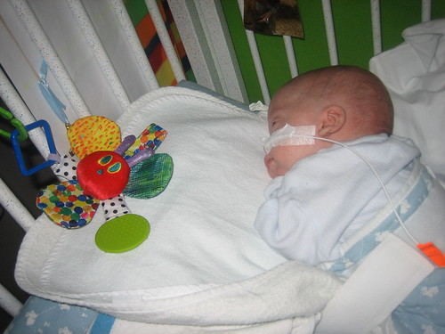 Max sleeping with crib toys