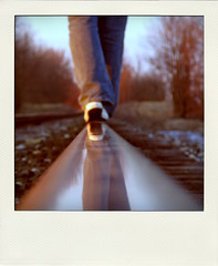 Rail Walker (Jeremy Stockwell) Tags: railroad selfportrait me headless vintage rail photofriday casual balance groundlevel unsharp railroadtracks lowperspective canonpowershots1is fauxvintage fauxlaroid jeremystockwell selfportraitchallenge poladroid jeremystockwellpix photofridaycasual