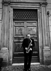 Sax In Rome (Sean Molin Photography) Tags: city vacation portrait blackandwhite bw italy musician man streets rome roma beautiful soldier person march europe italia european roman candid lifestyle alto epic saxophone gladiator streetmusician mediteranian vacationeuropeitalyrome2009marchvacationitalli vacationeuropeitalyrome2009marchvacationitallian seanmolin wwwseanmolincom