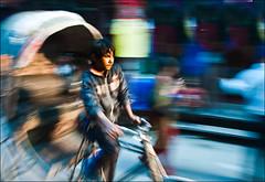 a rider in kathmandu (samthe8th) Tags: nepal motion bike wagon sam action works kathmandu pan trailer panning rider works2 matchpointwinner d700 flickrchallengewinner thepinnaclehof tphofweek152 mpt216