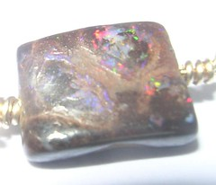 Australian boulder opal showing good fire amongst the ironstone host rock