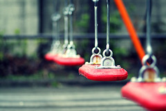 the 4 swings (jonathan vdk) Tags: park red wet water playground japan empty swings 85mm toyko waterdrops wetseat canon50d
