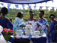 Fausta's give-away - Fausta cuts the cake for her family