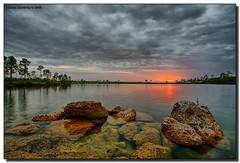 Everglades Sunset (Fraggle Red) Tags: sunset red orange sun lake clouds grey evening nationalpark rocks florida evergladesnationalpark jpeg pinetrees hdr stormclouds canonefs1022mmf3545usm naturesfinest enp 3exp bej anawesomeshot miamidadeco theperfectphotographer dphdr pinegladeslake guasdivinas cffaa