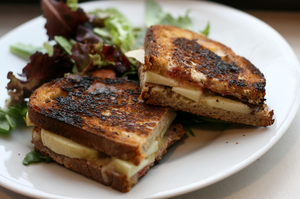 Cheddar and apple grilled cheese with raspberry coulis