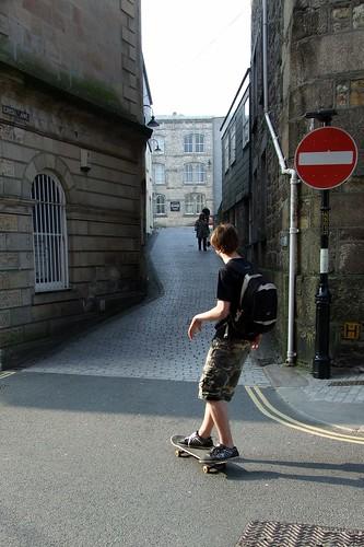 Skateboarder rolling