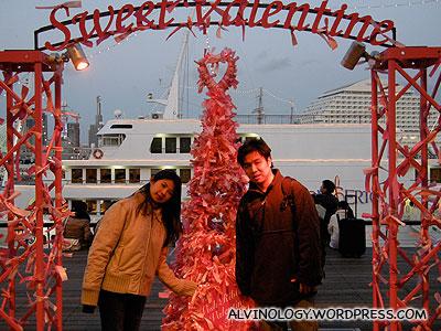 Mark and Meiyen beside a Valentines Day wishing tree
