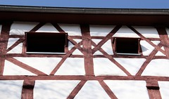 The eyes of the church in Hessberg (:Linda:) Tags: two church window architecture germany village open timber fenster gothic kirche bluesky thuringia blauerhimmel halftimbered fachwerk fachwerkhaus twowindows timberframing kirchenfenster wildermann hessberg timberconstruction wolkenloserhimmel kirchevonausen zweifenster churchwindowfromoutside