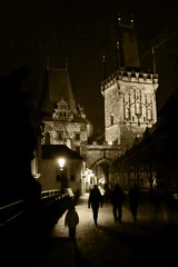 Shadows of Prague (Gilderic Photography) Tags: city bridge winter light shadow people cinema tower monument lamp monochrome silhouette sepia architecture night mono ancient europe mood tour czech prague perspective charles praha ombre story lumiere pont cinematic nuit karlov