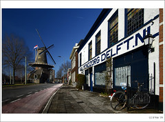 Delft Postcards: The Windmill (B'Rob) Tags: city bridge blue light sunset snow streetart holland color reflection bird art tourism church water netherlands bike bicycle azul architecture night square photography canal photo yahoo google arquitectura nikon flickr picture nederland thenetherlands tourist colores best explore cielo kerk zuidholland nieuwekerk d40 brob explored brobphoto