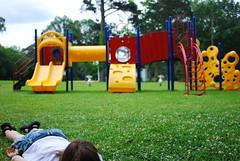Stop Motion (Camille Weaver) Tags: park girl grass playground nikon sister 28mm caroline slide nikkor teaser stopmotion d80