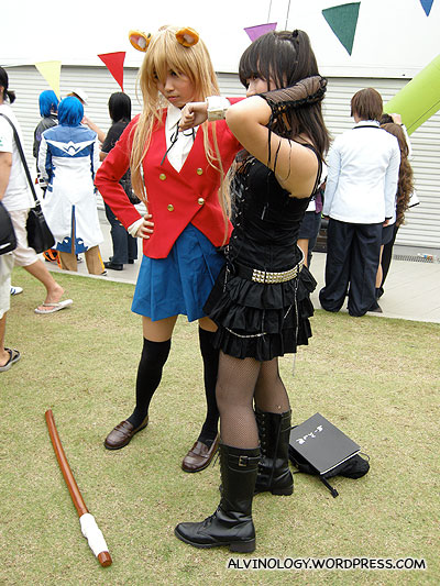 Girl in black is Misa in Deathnote, not sure about the other girl