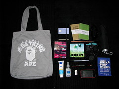 What's In My Bag?... (Cherrybomb Ink) Tags: london moleskine pen pencil ink magazine bag notebook hand cream jazz mini 3g diana kaws electronic tote lotion cherrybomb iphone fieldnotes antibacterial abathingape bape nigo finepoint cherrybombink